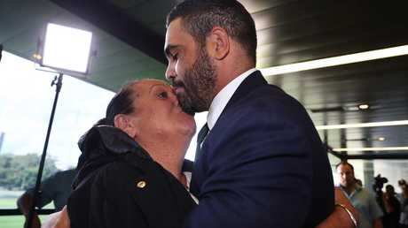 GI hugs his mother after announcing his retirement. Image: Brett Costello