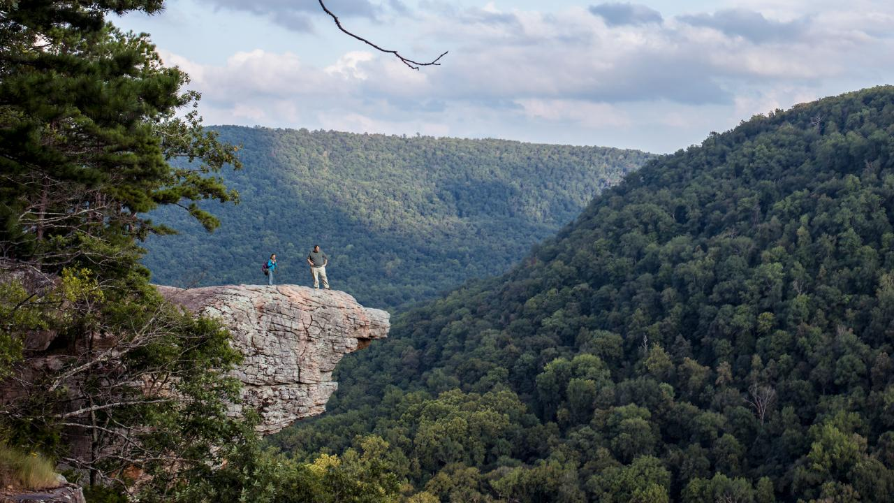 Hikers standing on the Hawksbill Crag in Arkansas, where police say Andrea Norton fell to her death. Picture: iStock