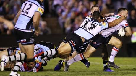 Tedesco breaks away to score a try against the Sharks. Image: Mark Kolbe/Getty Images