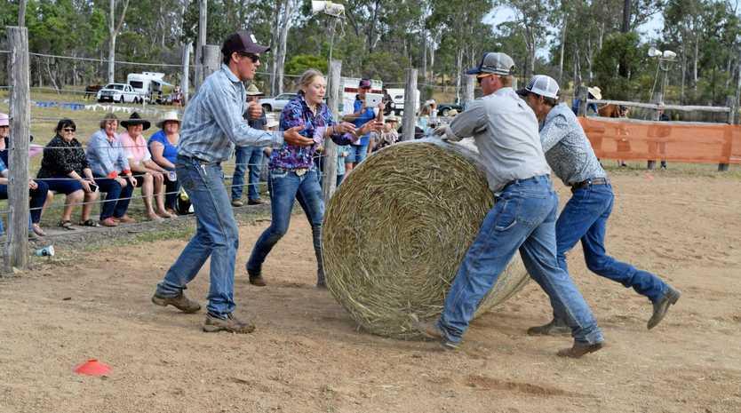 CHALLENGE: Cody Sauer, Teagan Bechly, Jack Daniels and Ryan Briskey rolling a bale in Dallarnil.