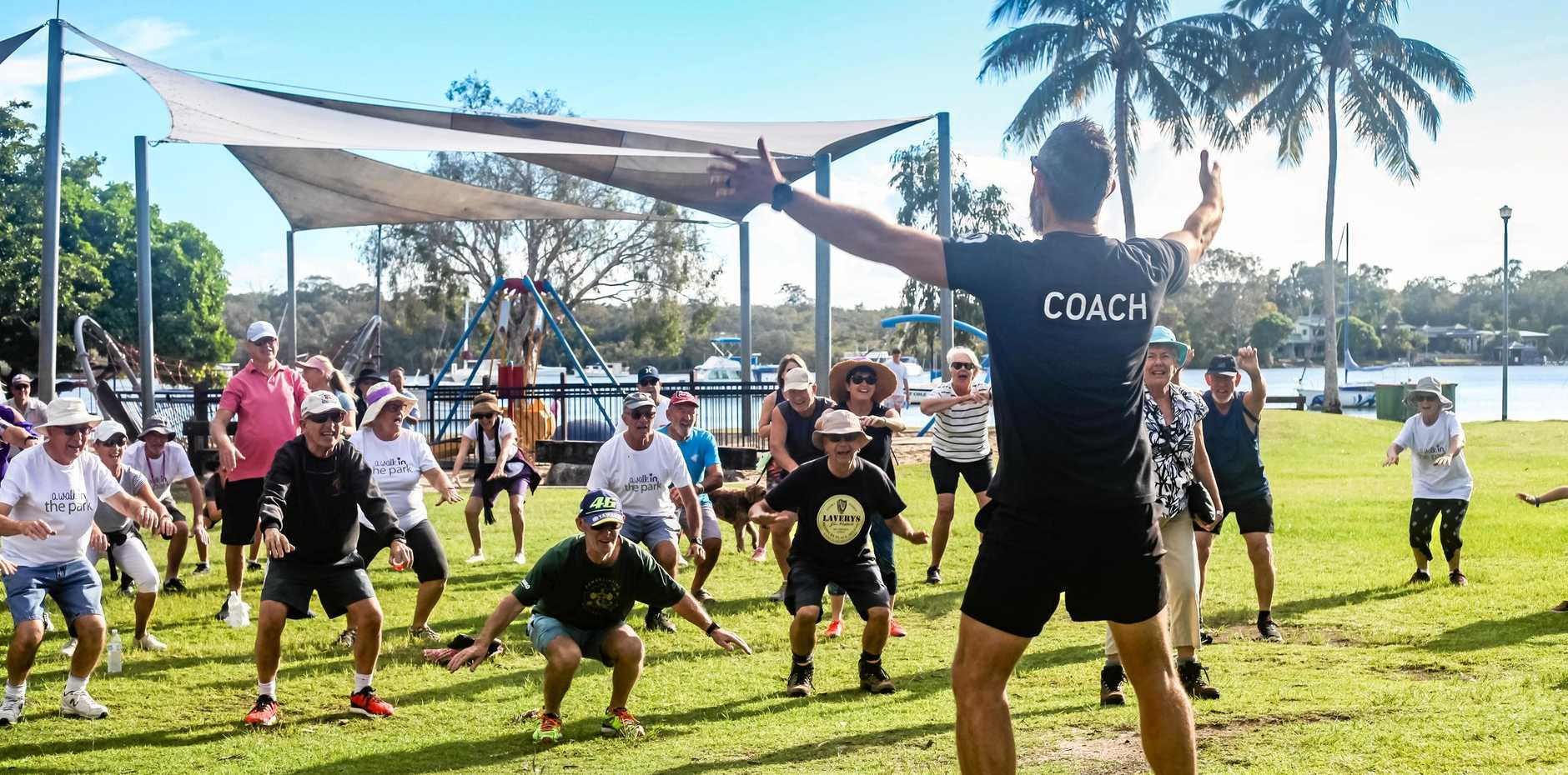 AWARENESS: Tewantin-Noosa Parkinson's Support Group participated in the annual Walk in the Park, but not before a warm up session with KOPD instructor