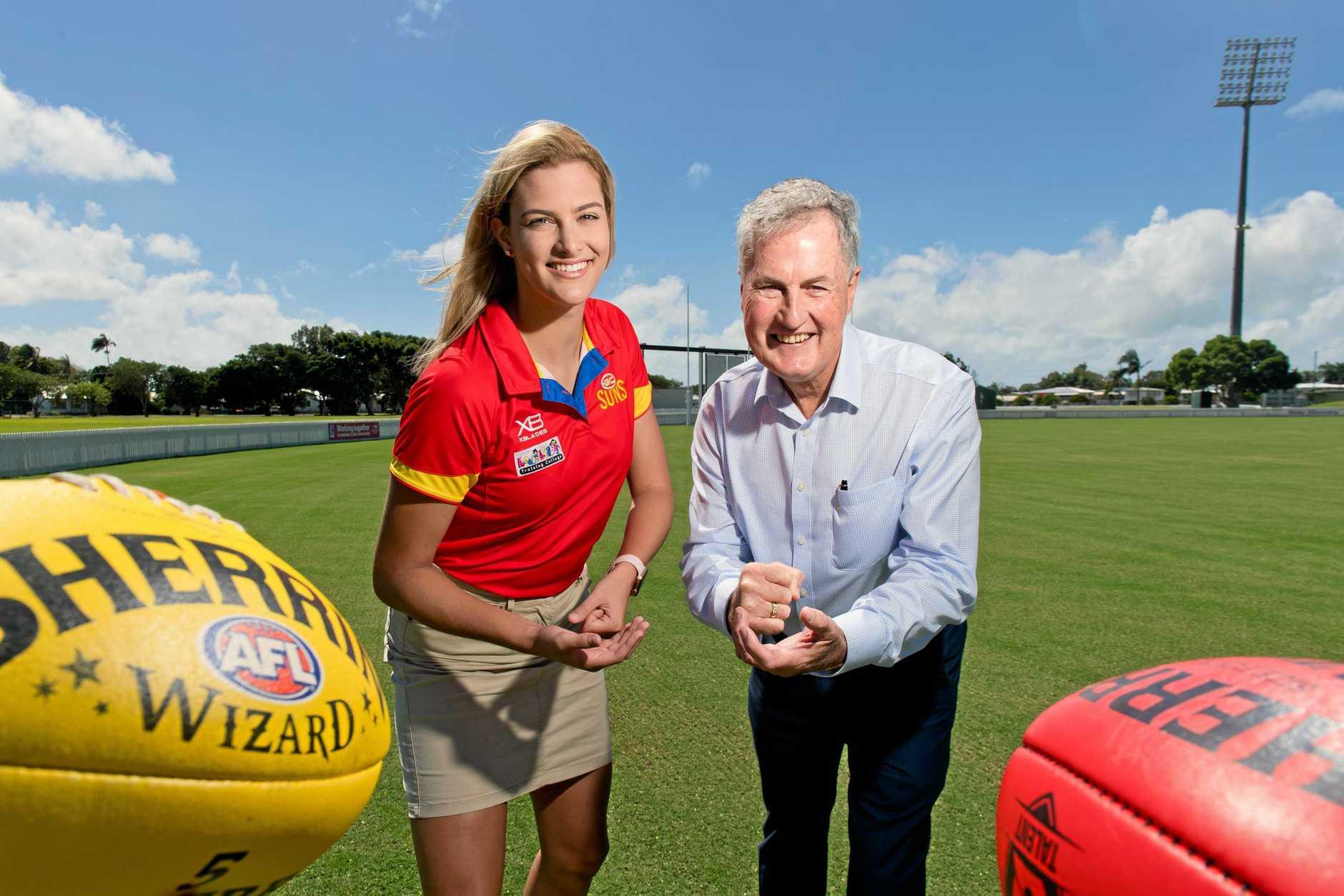 New Gold Coast Suns signee Lauren Bella with Mackay Regional Council mayor Greg Williamson.