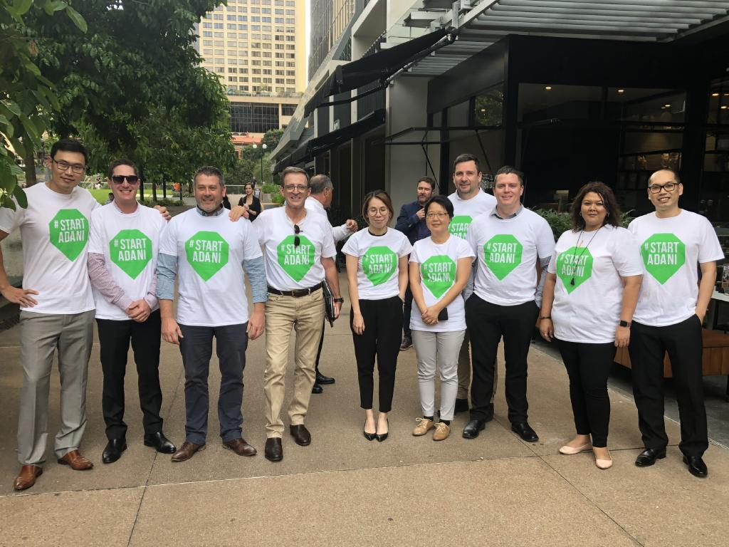 "Sentinel Property boss Warren Ebert took to the streets of Brisbane's CBD yesterday with nearly a dozen of his employees, all of them clad in white T-shirts with a ""#Start Adani'' logo coloured in the bright green of a go signal. Picture: Supplied"