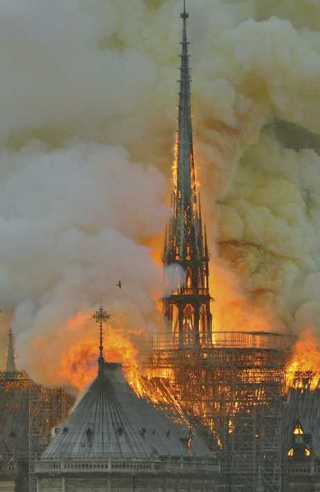 Flames and smoke rise from the blaze at Notre Dame cathedral in Paris. Picture: AP