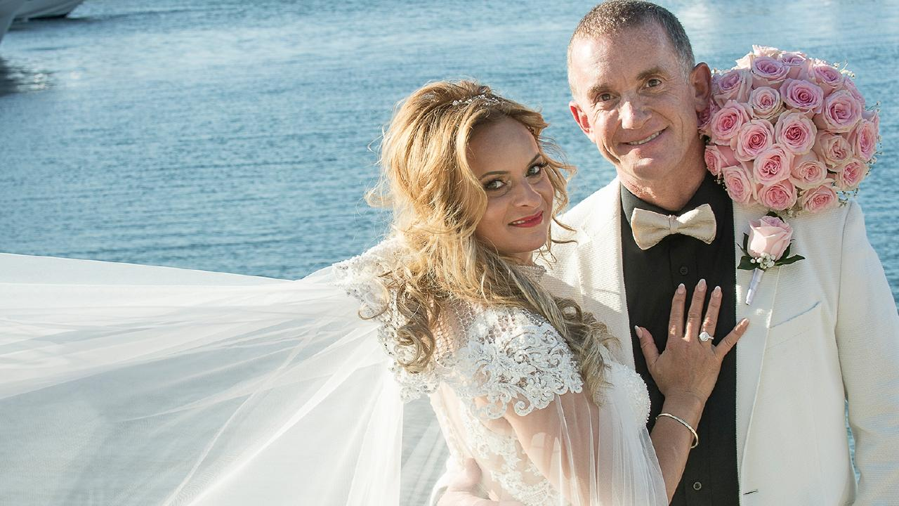 Mike Timoney pictured with Ildi Redak on their wedding day last year. Mr Timoney is accused, along with former chairman David Herlihy, of favouring the interests of Ms Redak's event management business over that of Smiles.