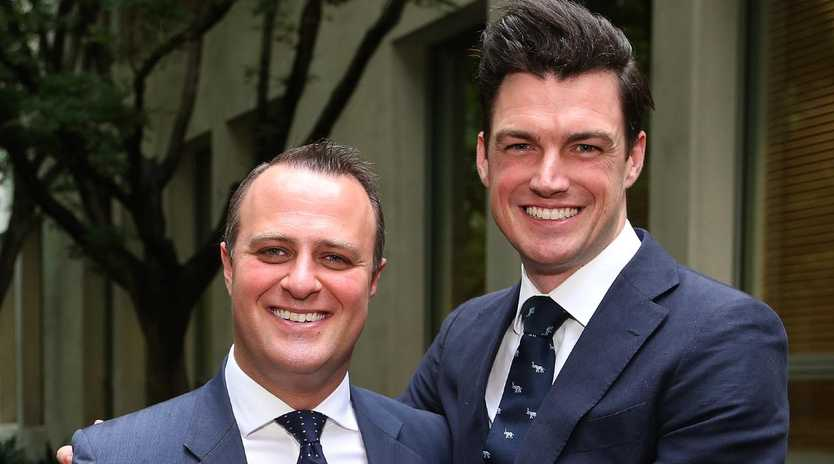Tim Wilson with his Partner Ryan Bolger after proposing to him during his speech on the Marriage Amendment Bill 2017.