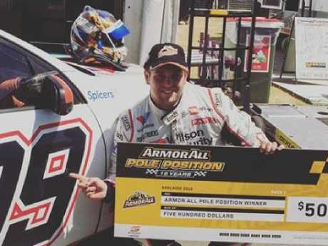 Mason Barbera, who runs M & R Farms, is a successful Supercar driver. Here he collects a cheque for pole position. Photo: Supplied