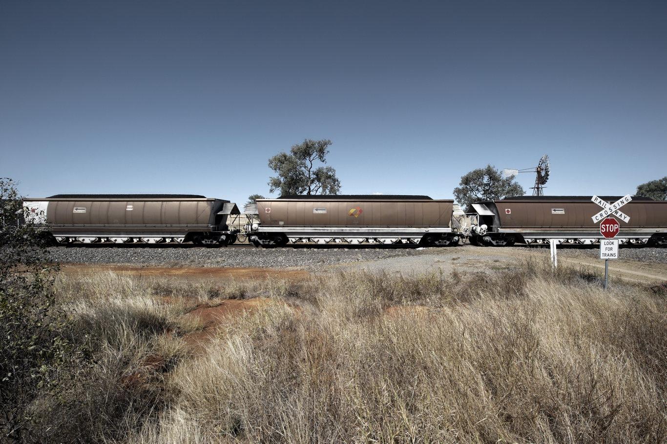 Aurizon coal train at level crossing.