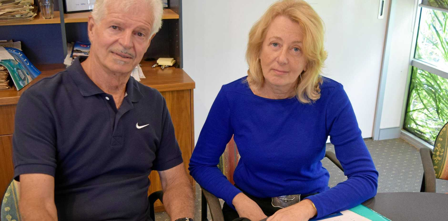 NOT ON: Tinbeerwah Neighbours and Friends Group members Tim Stranow and Kym Poole are not impressed by efforts to shift plane flights their way.