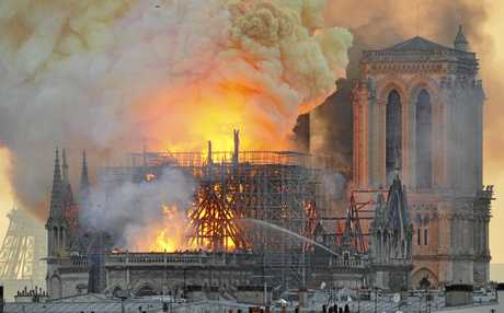 DEDICATED: Former Sunshine Coast Daily journlaist, Chloe Lyons (inset) is reporting from the scene of Notre Dame after a massive fire broke out at the 800-year-old cathedral and toppled the spire.