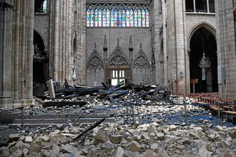 This general view shows debris inside the Notre-Dame-de Paris Cathedral in Paris on April 16, 2019, a day after a fire that devastated the building in the centre of the French capital. - French President Emmanuel Macron vowed on April 16 to rebuild Notre-Dame cathedral