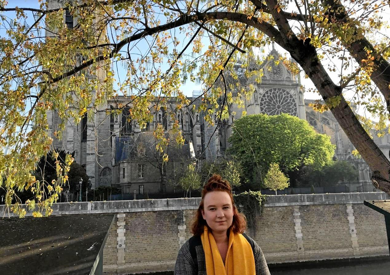 Former Sunshine Coast Daily journalist, Chloe Lyons outside Notre Dame, Paris in the scarf newspaper staff gave her as a leaving gift.