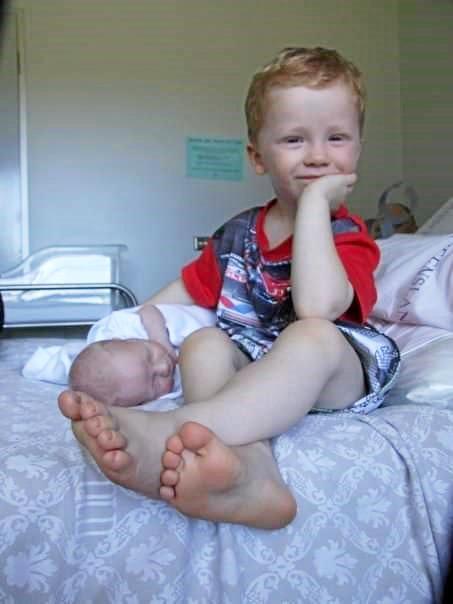 Kristy Hateley's eldest Mason Hotz, with newborn Casey, in the Theodore Hospital.