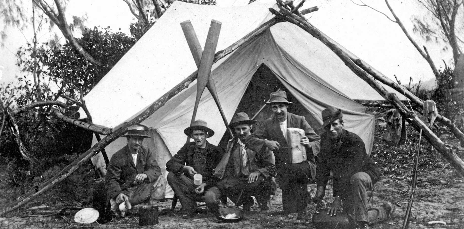 Campers in front of their tent on Pincushion Island at the mouth of the Maroochy River, Maroochydore, in 1906.