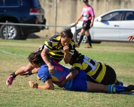 Gympie women take to the field for the Devils 20th anniversary celebration.