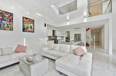 BRIGHT: The open plan living and kitchen areas are inviting.