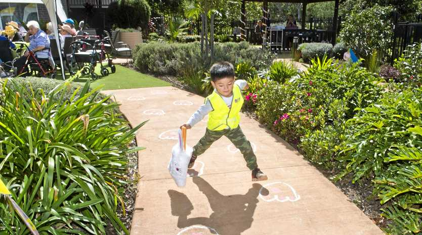 Gerald Siu hunts for eggs at Bupa Aged Care Rangeville.