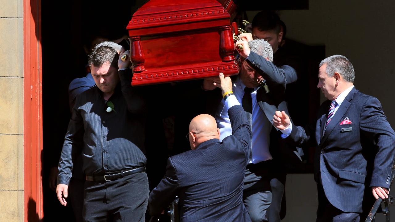 Karen's brother Stephen Williams (left) and Borce Ristevski (right) carry Karen Ristevski's coffin. Picture: Aaron Francis