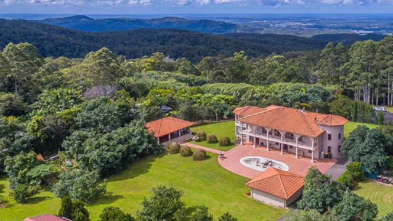 The castle-like house at 32 Eagles Close, Tamborine Mountain is listed with a $2.35 million price tag.