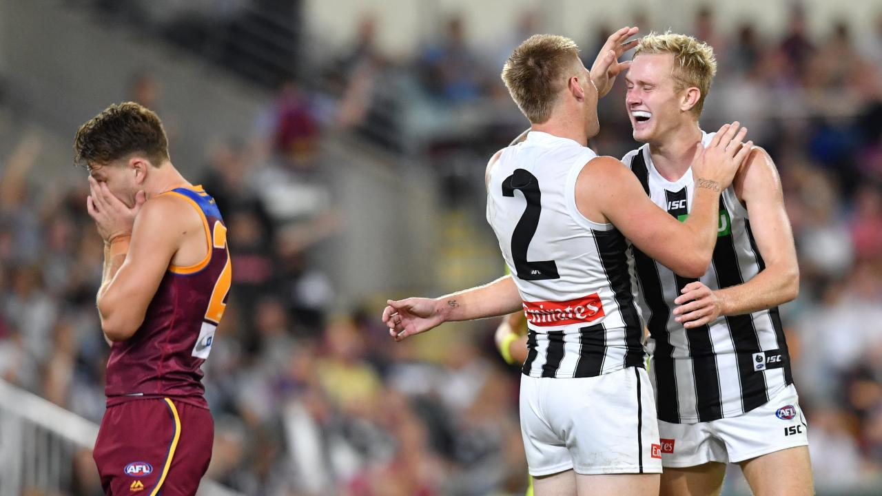 Jordan De Goey and Jaidyn Stephenson celebrate a goal during Collingwood's dominant second half. Picture: AAP Image/Darren England.