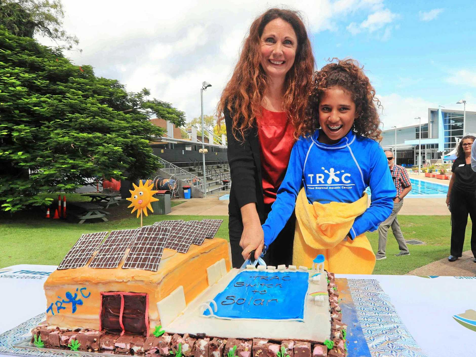 YUM FUN: Councillor Chris Cherry and local environmental champion, 11-year-old Alyce Togo cut a cake model of the Tweed Regional Aquatic Centre.
