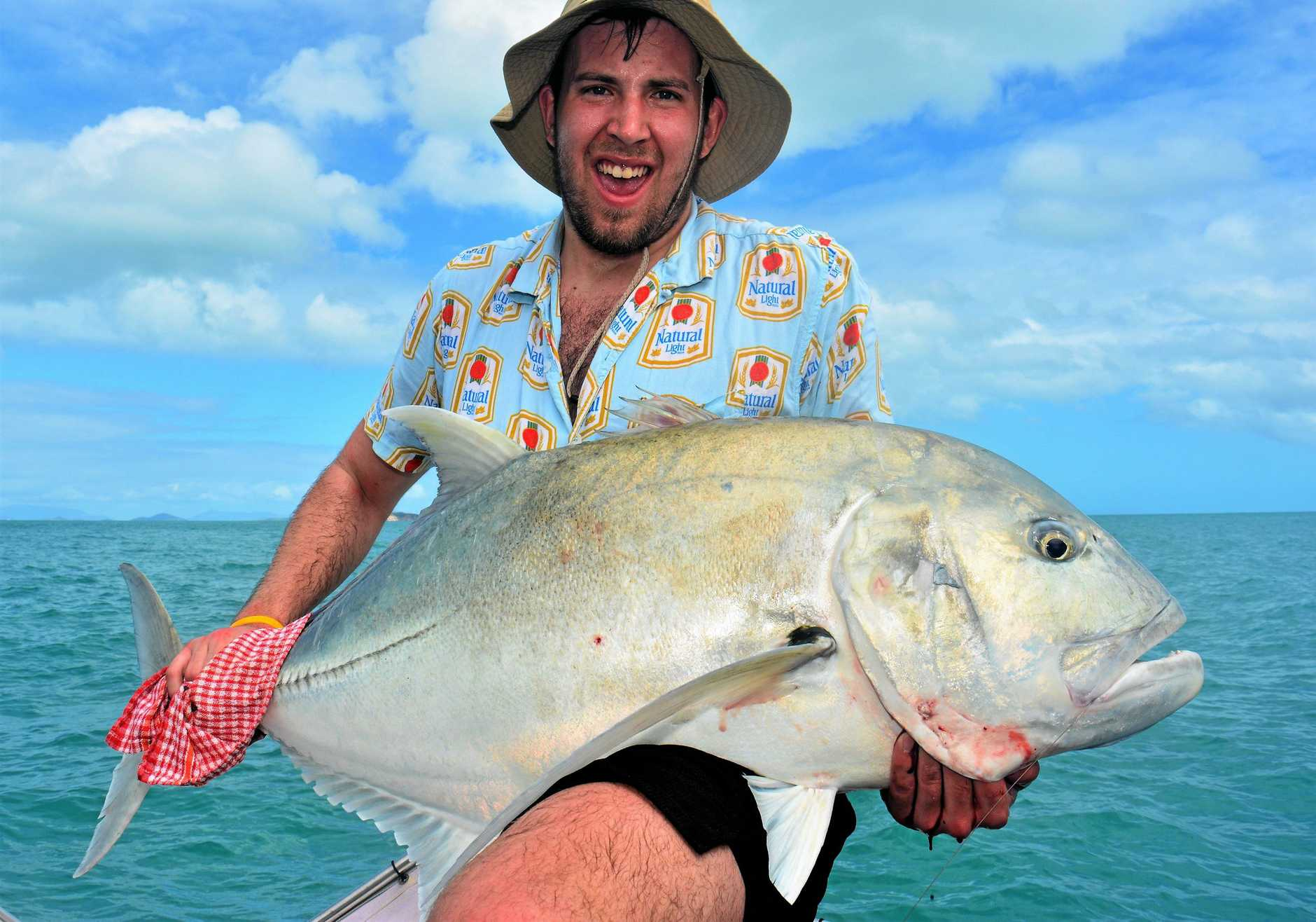 ABOVE: Visiting Canadian angler Reid Simpson with one of many hefty Giant Trevally that have been caught recently.