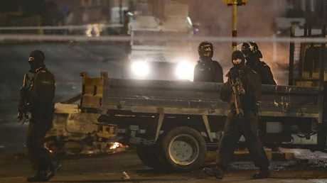 Police guard a crime scene during unrest in the Creggan area of Londonderry, in Northern Ireland. Picture: AP