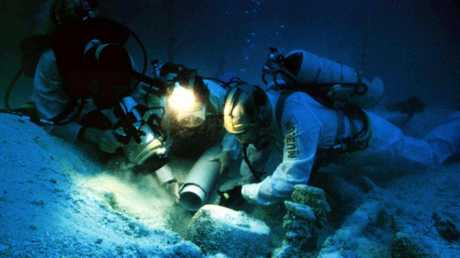 Maritime archaeologists and divers sift through materials at the site of shipwreck HMS Pandora off Cape York in 1998. Picture: Brian/Richards.