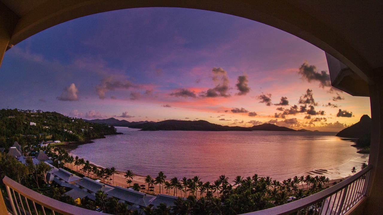 Sunrise over Catseye Beach with views to Whitsunday Island from Hamilton Island. Picture: Lachie Millard