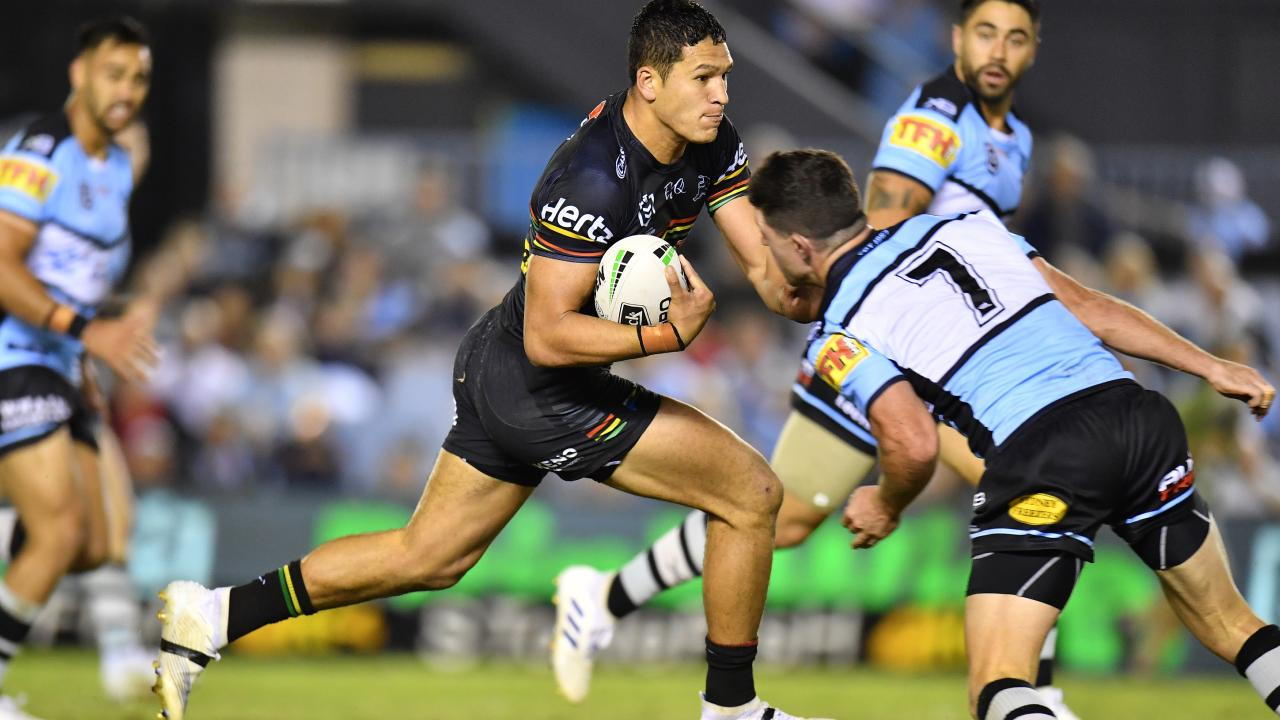 Dallin Watene-Zelezniak is lined cup for a tackle by Chad Townsend.