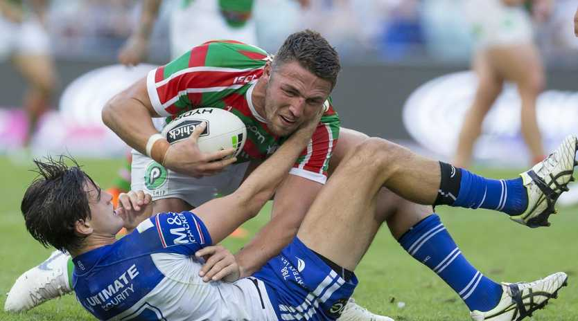Sam Burgess tries his best to get rid of Lachlan Lewis. (AAP Image/Craig Golding)