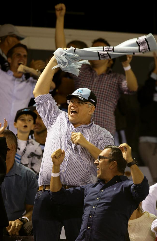 Prime Minister Scott Morrison celebrating as his team the Cronulla Sharks make a comeback against the Penrith Panthers at PointsBet Stadium. Picture: Jonathan Ng