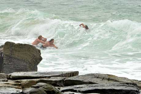 UNTHINKING: Four men at the north end of Mooloolaba swim in a dangerous situation.