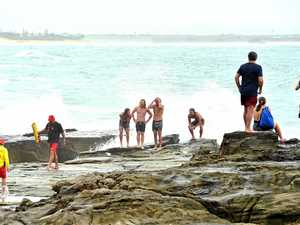 Swimmers risk life and limb in treacherous rock dive