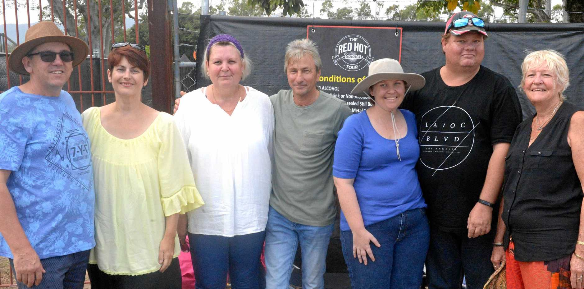 Shaun and Megan Benn of Gladstone; Jacqui and Wayne Frazer of Gracemere; Leonora and James Casey of Eidsvold; and Rhonda Reed wait for this afternoon's Red Hot Summer Tour concert