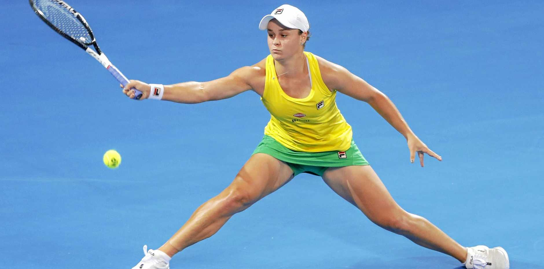 Ashleigh Barty at full stretch against Victoria Azarenka in their Fed Cup World Group semi-final match at Brisbane's Pat Rafter Arena. Picture: Glenn Hunt/AAP