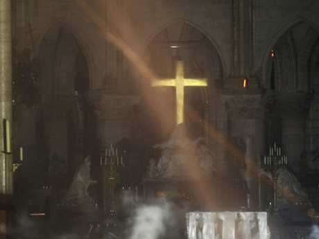 Smoke is seen around the alter inside Notre Dame cathedral in Paris. Picture: AP