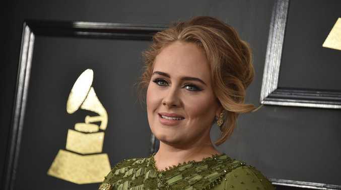 Adele confirms split from husband