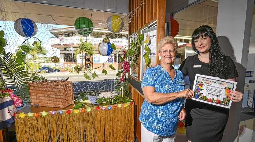 Auswide Bank Gladstone branch manager Rebecca Allison with QUOTA Club of Gladstone members Wileen Weeden and Carol Hartley, after the bank won the tropical Wednesday competition.