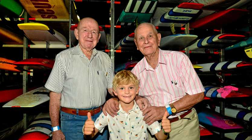 THE YOUNG AND THE OLD: Its 100 years this Easter since Coolum Beach received their first surf reel. Ron Want and Keith Petrie with Malachi Nagle, 6.