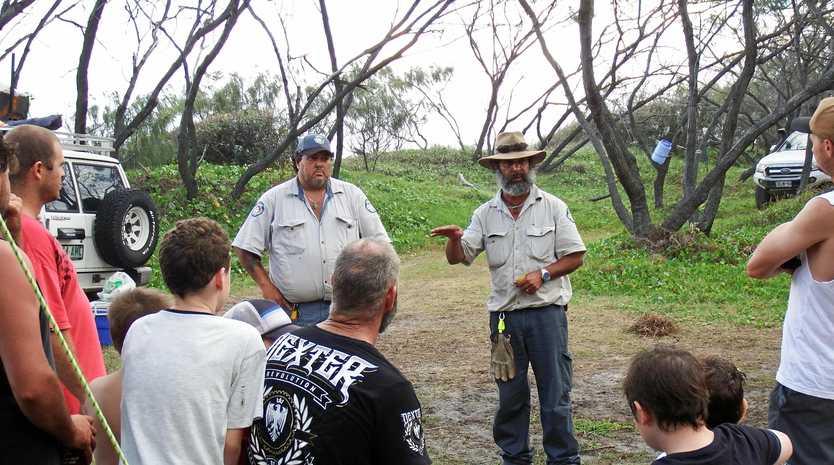 STAY SAFE: Fraser Island rangers delivering dingo-safe messaging to campers.