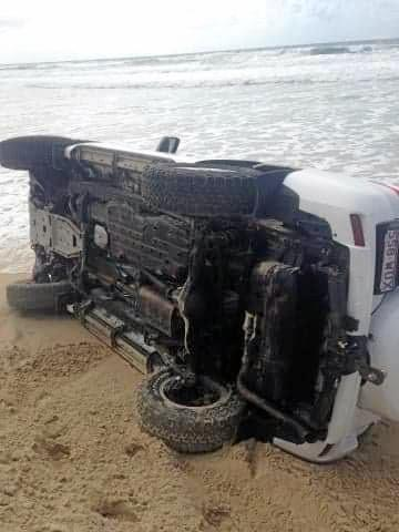 A driver in a new looking Prado is the latest victim of soft sand and big drop offs on Teewah beach.