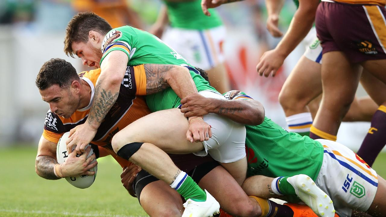 CANBERRA, AUSTRALIA - APRIL 21: Darius Boyd of the Broncos is tackled during the round 6 NRL match between the Canberra Raiders and the Brisbane Broncos at GIO Stadium on April 21, 2019 in Canberra, Australia. (Photo by Mark Kolbe/Getty Images)