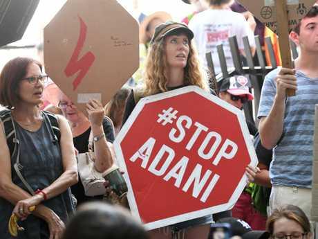 Anti-Adani protesters stage a sit-in last December in Brisbane. Picture: AAP/Dan Peled