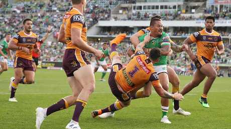 Joey Leilua sends Broncos flying on the way to the tryline. Picture: Mark Kolbe/Getty Images