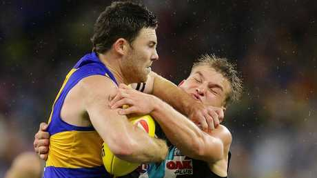 Jeremy McGovern and Ollie Wines grapple in the Power's win at Perth Stadium. Picture: Will Russell/Getty Images