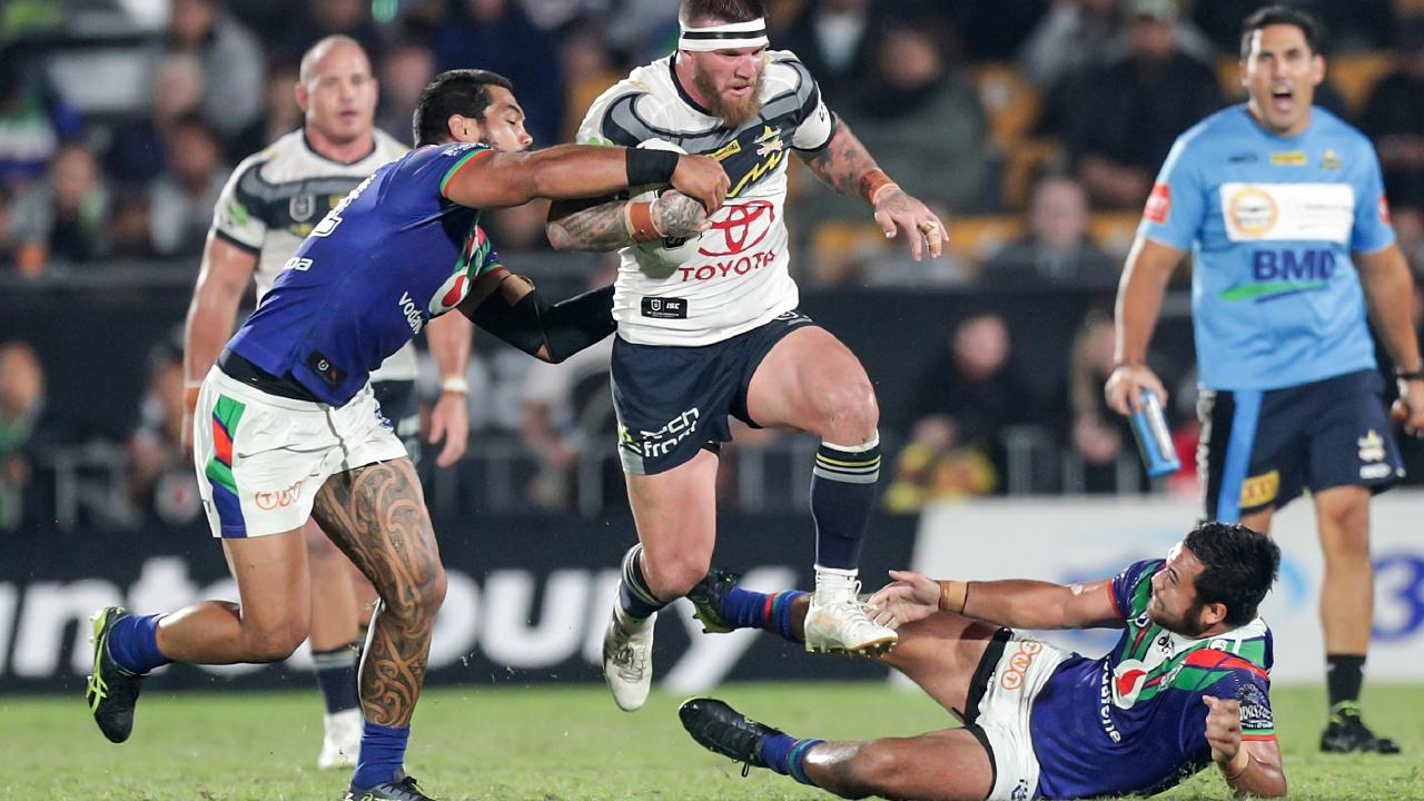 Josh McGuire of the Cowboys breaks past Adam Blair (left) and Peta Hiku of the Warriors during the Round 6 NRL match between the New Zealand Warriors and the North Queensland Cowboys at Mt Smart Stadium in Auckland.