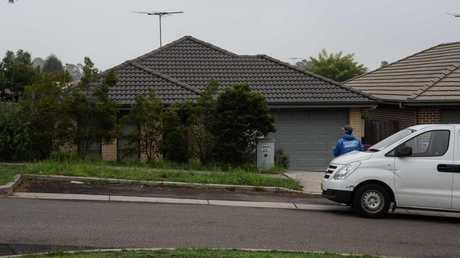A man is in custody after a woman's body was found in a home in Sydney's southwest on Sunday morning. Picture: Monique Harmer