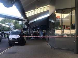 Man dies outside Woolworths while crowd walks past