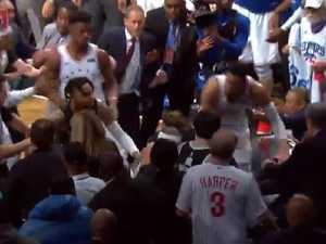 Wild NBA brawl falls into stands